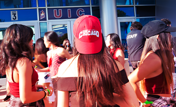 Female student wearing a chicago hat