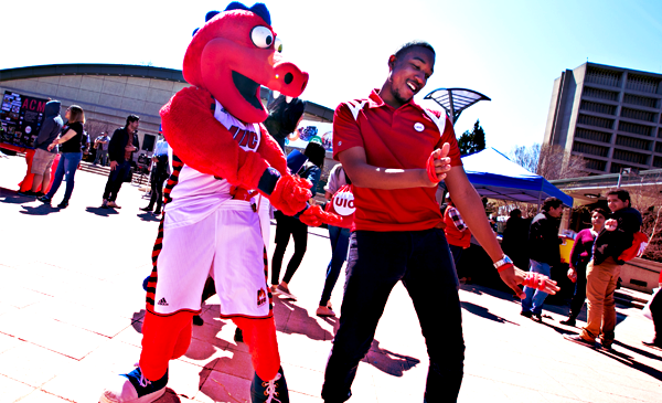 student dancing with mascot